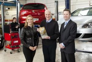 Vicki Butler-Henderson presents the award to Kinghams of Croydon
