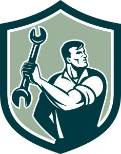 Illustration of a mechanic clinching holding spanner wrench looking to the side set inside shield crest on isolated background done in retro style.
