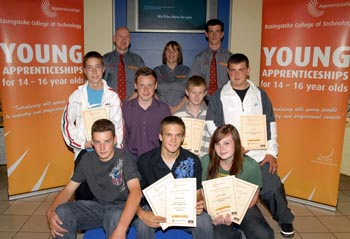 The young apprentices show off their awards