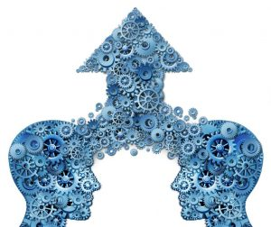 15584417 - corporate partnership and business teamwork growth concept with two human head shapes merging together to form an upward pointing arrow made of gears and cogs as a financial success symbol on a white background